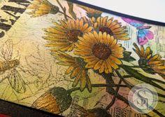 Designed by Jodi Clark for Spectrum Noir. Spectrum Noir markers Daisy – GB9, GB7, GB4.  Leaves – DG4, DG3, DG2. Butterfly – IB3, IB1, BP4, BP1. Background – LG5, BP2, CT3, PL3, IB2. Perfect Pearls Mists – Sunflower Sparkle, Forever Green, Mint, Kiwi, Sour Apple. Art Anthology Dimensional Paints – Dazzle, Kenyan Copper, Leaf, Vegas Gold. Art Anthology Sterling Fairy Dust shimmering spray. Stamp-Technique Junkies Vintage Daisy Collage.