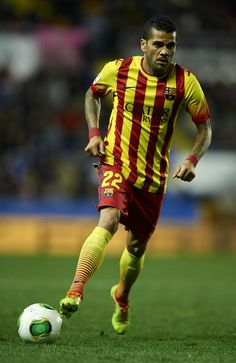 Daniel Alves of Barcelona runs with the ball during the Copa del Rey Quarter Final First Leg match between Levante UD and FC Barcelona at Ciutat de Valencia on January 22, 2014 in Valencia, Spain.