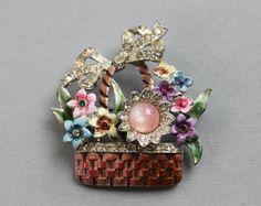 1942 CORO Flower Basket Brooch / Adolph Katz / Enamel Moonglow and Rhinestone Pin by TheHiddenChamber on Etsy https://www.etsy.com/ca/listing/235657454/1942-coro-flower-basket-brooch-adolph