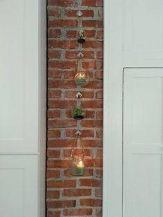 Exposed brick chimney in kitchen