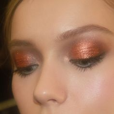 Coppery bronze eye at J Mendel...makeup by Gucci Westman using Revlon of course
