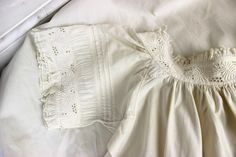 Ca.1860s cotton chemise with foliage-themed embroidered bands and puffings. Ebay seller Sarah Elizabeth Gallery.