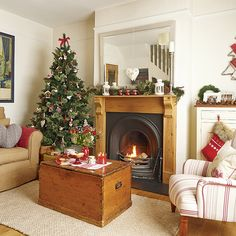 Country Christmas living room with neutral walls, wood flooring, neutral rug, white and red striped upholstered chair and Christmas tree Scandi Christmas, Christmas Interiors, Christmas Living Rooms, Christmas Post, Country Christmas, Simple Christmas, Christmas Themes, Christmas Decorations, Handmade Decorations