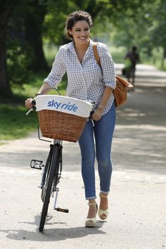 Kelly Brook Photos - Kelly Brook smiles while attending a Skyride Bicycle ride in Regents Park. - Kelly Brook Rides a Bike