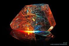 This Rutilated Quartz piece shows of a rainbow colour effect.  Photographer : Marc Geuzinge rocks , minerals, stones, cubic shape, natural gems, orange, blue, light