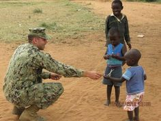 """Elijah Maine, CEO of #SupportMilitaryMuscle shares..... """"""""In 2011 I was very fortunate to be deployed to Uganda Africa. I was able to use my skills and connections to help the UNFORTUNATE. ONE of my memorable moments was caught on camera for NAVY TIMES. I loved helping those who needed it way more than I did. I built schools and helped refurbish broken down building for school children to live in and inhabit.  Military muscle is not just about fitness. It's about being strong!"""