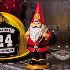 The Garden Friends Heroic Gnome - Fireman is the perfect mascot for any firehouse. This charming gnome is dressed head to toe in the proper attire,. Gnome Statues, Garden Statues, Firefighter Decor, Firefighter Family, Outdoor Statues, Fire Department, Fire Dept, Gnome Garden, Garden Tools