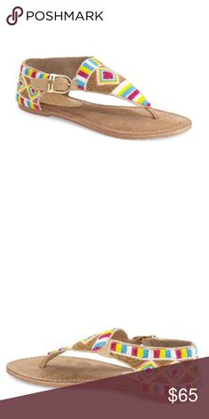 """Aztec Multicolor Hand Beaded Sandals Geo-patterned beading livens up an essential thong sandal secured with an adjustable buckle strap. Adjustable strap with buckle closure. Leather upper and lining/synthetic sole. Coconuts by Matisse; imported. Heel measures approximately 0.5"""" hand beaded body Free People Shoes Sandals"""