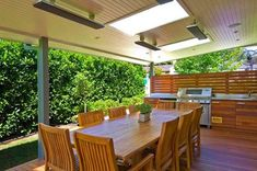 Outdoor eating area with BBQ outdoor heating installed