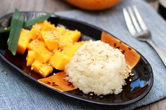 Mango Sticky Rice Serves 4 | Prep Time: 15 minutes | Cook Time: 20-25 minutes  Ingredients:  1 cup (200g/7oz) glutinous rice 2-3 Pandan (screwpine) leaves, cut into 2-inch length 2-3 Asian mangoes, cut into small cubes 1 cup (250ml) coconut milk 1/2 teaspoon salt 1/4 cup (55g/2oz) sugar 1 tablespoon toasted sesame seeds, optional  Optional: Banana leaf for steaming
