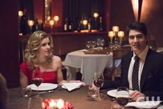 """The Flash -- """"All Star Team Up"""" -- Image FLA118A_0147b -- Pictured (L-R): Emily Bett Rickards as Felicity Smoak and Brandon Routh as Ray Palmer-- Photo: Cate Cameron/The CW -- © 2015 The CW Network, LLC. All rights reserved.pn"""