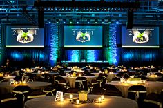 Love this! Simplistic Tables with dramatic lighting. #Events #Corporate #Decorations