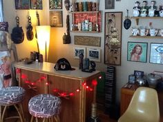 Tiki corner of the Iiving room. Got the Heywood Wakefield bar and stools for $20 at an auction..