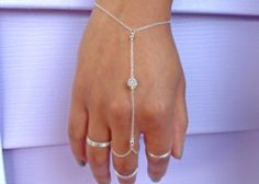 Sterling Silver dainty hand chain. This hand chain is dainty but very sturdy. The perfect accessory to complete the look!!! It can also be layered with other dainty bangles, bracelets and rings!!!