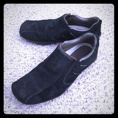 Mens Skechers black suede Slip-on Just right for style and comfort. Soft suede upper with a low profile sporty look. Casual slip on sneaker has stitching overlay and perforation accents. Padded collar. Skechers  Shoes