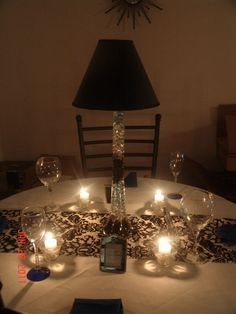 I like the table runner and candles. Can you imagine a one layer cake on a pedestal cake plate??