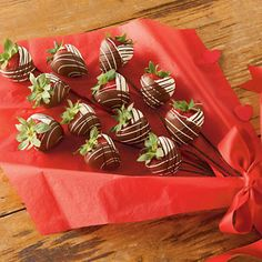 Long Stemmed Chocolate Dipped Strawberry Roses - A dozen long stemmed roses is a nice gift. Really sweet, even. A dozen strawberries dipped in white and milk chocolate would be even nicer.