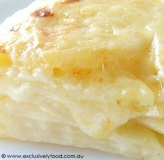 Creamy Potato Bake Recipe ~ A rich, creamy sauce oozes from between layers of tender potato slices in this cheese-topped potato bake!!