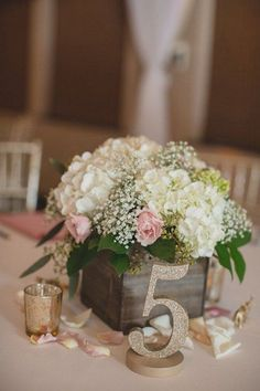 glitter table number with cute pink and white flower box centerpiece / http://www.himisspuff.com/wooden-box-wedding-decor-centerpieces/17/