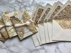Gold and ivory invitation card with envelope liner  #weddinginvitation