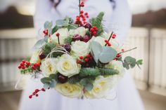 Winter wedding bouquet, via 'Retro Red and Polka Dots For A 1950s Style Village Hall Christmas Wedding'.  http://www.lolarosephotography.com/
