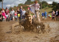 A young man dives through the mud at Leeds Festival, making the most of the wet and windy . British Holidays, A Level Textiles, Dove Men, Enjoy The Sunshine, Great British, Music Festivals, Leeds, Young Man, Mud