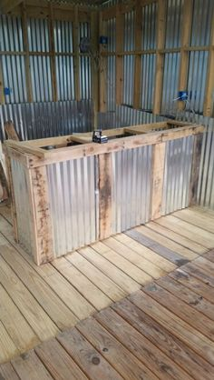 Front of bar with tin and pallet wood trim. Almost ready to put on a bar top.
