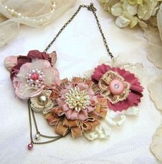 nice example of an antique style ribbon flower in the center of this otherwise grandmotherly necklace