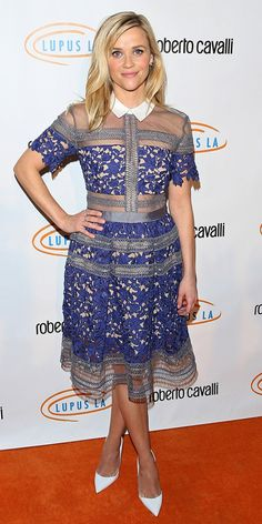 Reese Witherspoon looks perfectly sweet in a  purple lace collared dress.