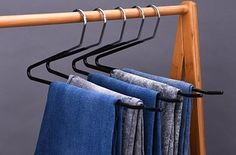 A of open-ended, non-slip pant hangers so you don't have to pile all your trousers together. Carrie Bradshaw would NOT approve. 28 Things From Walmart That'll Organize Every Room In Your Home Closet Hacks, Closet Tour, Pant Hangers, Clothes Hanger, Hanging Pants, White Vanity Bathroom, Bathroom Black, Small Bathroom, Clutter Organization