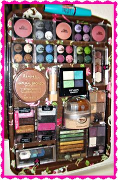 DIY magnetic makeup board with a decorated cookie sheet. You can also make this with a picture frame and sheet metal.