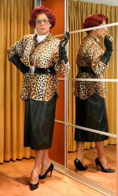 Mrs Wanda Nylon in leather skirt and buttoned leather gloves