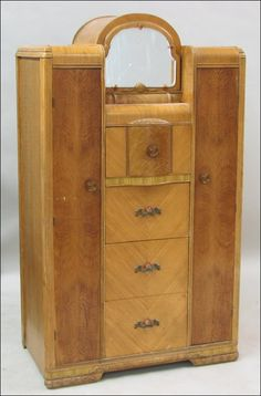 "ART DECO STYLE WALNUT VENEER AND INLAID CABINET. With raised central mirror H: 68"" W: 40"" D: 21"""