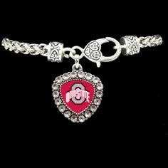Crest Crystal Bezel Bracelet Ohio State University F51205-OSU Fashionable Ohio State University team jewelry. Braided look silver toned bracelet. Take note of the special heart shaped lobster style clasp with dangling charm featuring crystals surrounding Ohio State University logo. Finish: tarnish protected pewter and zinc. Lead, nickel, and cadmium safe