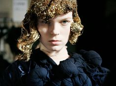 glittery wigs backstage at comme des garçons.