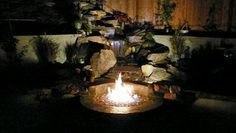 This is a great Water and Fire feature. Use the waterfall kit from Costco and build your own fire pit at the bottom. Run electrical and gas line for this one.