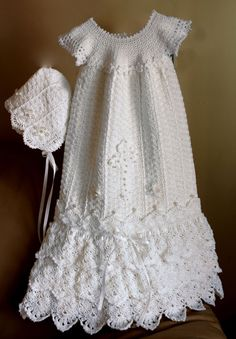 Serenity Gown Crochet Pattern from Crochet Garden - If you have been searching for something special, something so stunning for that most memorable moment of new beginnings, you have found it. This gown will be an heirloom to pass on for generations. Sizes span from preemie to 12 mos. Available from www.MaggiesCrochet.com