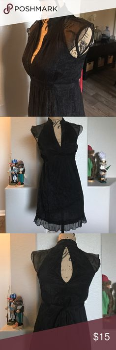 Black dress This beautiful dress is in good condition. It does have a small hole in the hole in the back but it is not noticeable because of the dresses lining. Dresses