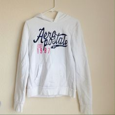 | SALE | logo sweatshirt Comfortable, cute Aeropostale hoodie! White with blue and pink lettering. Some small stains on pocket, discount applied! Size M. Aeropostale Jackets & Coats