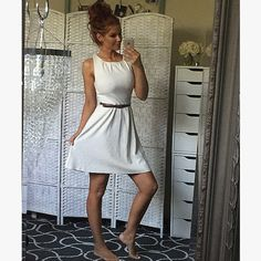 Fun and girly striped cream dress Comes with belt and is very feminine. Love the coloring and great on any skin tone. Amazing for summer. Dresses