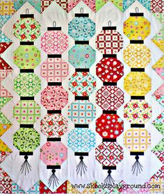 Glow Happy Quilt Top - This Chinese lantern design could be adapted into a cool EPP block