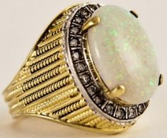 "Elvis' 14KT gold Vintage ""Opal"" Diamond Ring that He wore on his pinkie finger."