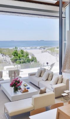 This indoor/outdoor living room certainly makes for a view I could sit in and enjoy.  Gosh, right there on the sand!  I wish I could see what the rest of this home looked like.