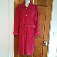 Michael Kors Raspberry suede trench coat NWT This is a long suede trench coat in a pretty raspberry color by Michael Kors.  It has two side pockets.  There is a silver buckle detail at the shoulders.  It has a buckle belt.  It has a silk lining and buttons up the front.  It's new with tags.  Originally  $598.99. Michael Kors Jackets & Coats Trench Coats