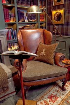Library with green built-in bookcases and plaid walls -- Nicolas Smith Photography -- Scot Meacham Wood Design