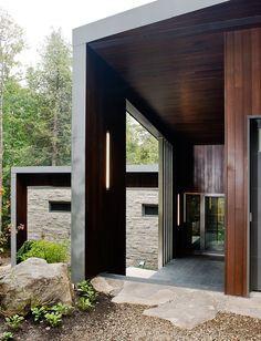 Montauk grey slate and Prorez cedar siding facade of Quebec vacation home by boom town.