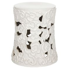 Accent your patio seating group or sunroom decor with this lovely ceramic garden stool, showcasing an openwork swirling motif in white.