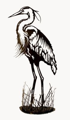 Ship in 1-3 weeks Limited Edition A graceful blue heron standing in a circle of reeds. Perfect for a corner or inside beside the front door. Now offered in 2 sizes, the large size is 42'' tall and the