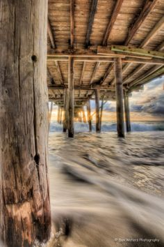 Under the boardwalk, down by the sea....