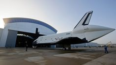 April 19, 2012. Space Shuttle Enterprise (OV-101) rolls back out of the James S. McDonnell Space Hangar of the Smithsonian National Air and Space Museum's Steven F. Udvar-Hazy Center prior to transfer ceremony.  Discovery (OV-103) will take Enterprise's place on permanent display in the Space Hangar.  Photo Credit: (NASA/Paul E. Alers - 201204190010HQ)